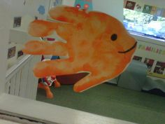 Create a goldfish with a hand print -- created by little artists at KinderCare.