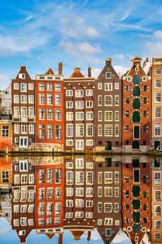 Amsterdam, The Netherlands, red brick canal houses and their reflections.