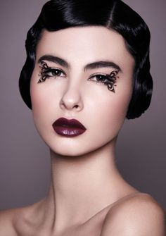 vintage vibe. butterfly lashes and burgundy lips.