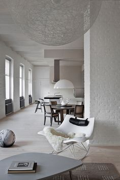 Tones of white and cream with the Stingray Rocking Chair http://www.nest.co.uk/search/fredericia-stingray-rocking-chair and Moooi Random Suspension Light http://www.nest.co.uk/search/moooi-random-suspension-light