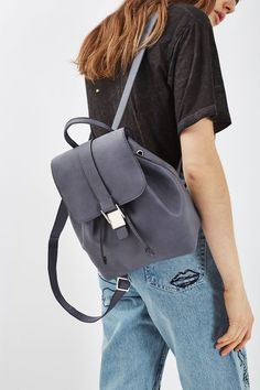 Jump on the backpack bandwagon by investing in this cool style. This bag comes in a small size with gold buckle detail with drawstring and mag dot fastening. #Topshop