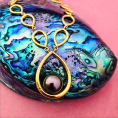 Large black pearl on a gold teardrop necklace.    #pearl #gold #blackpearl #culturedpearls #necklace