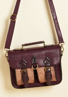 A long time ago, when the world was full of wonders, there was this faux-leather bag - a ModCloth exclusive. What made this maroon satchel so special was its brown basket-woven pockets, dual buckle closure, and in-house and out-and-about hauteness, which created a feeling of home everywhere this bag traveled.