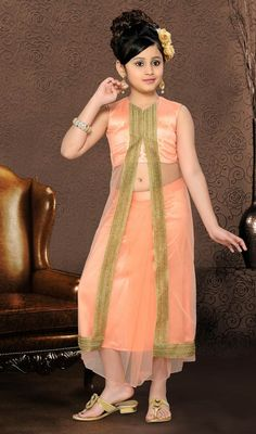 Be the perfect picture of elegance as you drape into this peach puff shade net embroidered gown. The ethnic lace work to gown adds a sign of beauty statement to your look. #FancyLookAntiqueStyleGown