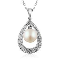 This beautiful pearl and diamond pendant is crafted of 18k white gold. The 0.09 Carat T.W. pavè diamond drop pendant holds a 6mm freshwater pearl.
