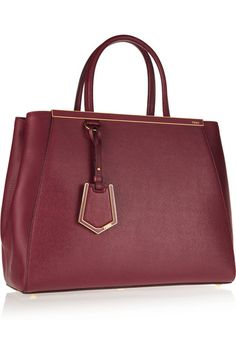Fendi 2Jours medium textured-leather shopper - Crafted from a luxe combination of smooth and textured burgundy leather and detailed with gold hardware, Fendi's '2Jours' shopper is timelessly chic. This medium bag is fully lined in designer-stamped jacquard and features one zipped pocket and two patch pockets.