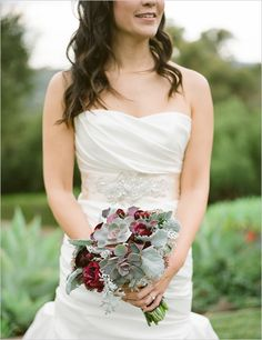Love the use of deep red & succulents in this bouquet.