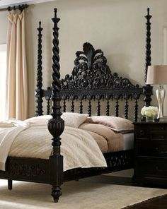 ornate bed is the focal point, contrasting wall color makes it pop.