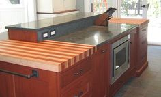 2-1/2 inch Cherry and Maple Stripe Wood Countertop in red and blond colors with a 1/8 inch Roundover edge profile and a Food Grade Oil Finish. Designed by Blue Bell Kitchens.