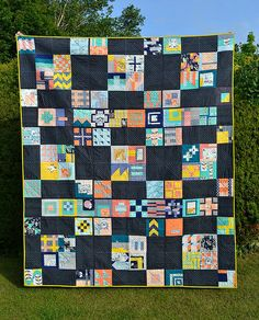 City Sampler Quilt: colors (grey, pink, yellow, blue variations)