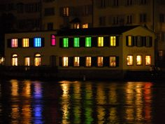 Colorful Zurich Ladenlücke building on the Limmat River as it runs through the center of Zurich, Switzerland. Run Through, Zurich, Switzerland, Colorful, River, Building, Buildings, Construction, Rivers