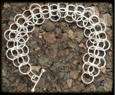 Classic Lace Bracelet   The intricate design of multiple 18 gauge, 10 mm circles, gives this classic design the illusion of a lace pattern.        Retail:  $130.00  Sale:      $78.00