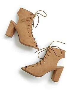 Better go get that pedi you've been putting off; these shoes make it a requirement. These tan faux suede booties have a cutout heel with a lace up open front and a peep toe. So basically these sexy heels are for nights with the squad only. Wide Width Shoes.