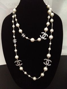 Vintage Designer Chanel Inspired Silver CC Long White Pearl Necklace. $65.50, via Etsy.