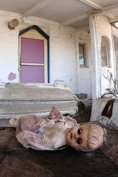 Abandoned doll inside an abandoned house  ---   (by slworking2, via Flickr)