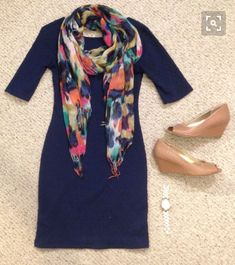 Sweater dress paired with colorful scarf and nude wedges.