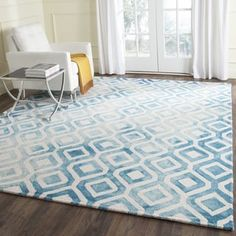 Safavieh's Dip Dye collection is inspired by timeless vintage designs crafted with the softest wool available. This rug is crafted using a hand-tufted construction with a wool pile and features main a