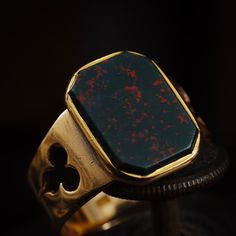 The front of the ring in the previous post. Look at that lovely even speckling and rich patina of the Gold. Bloodstone is a variety of Jasper with iron oxide inclusions which create the 'blood' spatters. In Victorian times these stones were sourced from the mouths of Scottish rivers and used in jewellery. The style of this wonderful ring is very much of it's time and distinctive in that the Arts and Crafts movement was very much one which was initially centred in the British Isles and…