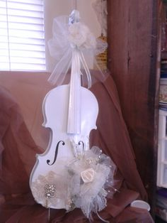 Wooden Violin painted white with hand made flowers by Joye Hinton. Contact me at www.joyeahinton.com or email me a jvh3@bellsouth.net