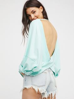 Back It Up Pullover   Washed lightweight pullover featuring a dramatic surplice open back.    * Oversized silhouette   * Ribbed trim   * Long dolman sleeves