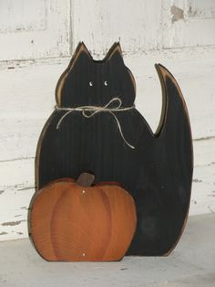 This primitive wood cat and pumpkin will make a nice shelf sitter for your fall Halloween décor. It has been distressed all over for a prim look. Measures approx. 8w x 10 1/4high.