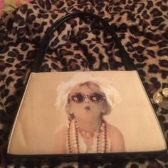 Vintage beige purse Beige / tan/ yellow background with a little girl playing dress up on both sides. Only damage is a black mark on one of the sides. Purse is supposed to look like an old photo so it is tinted yellow. The inside is plaid . Received this when I was young but have no use for it anymore. Hard to part ways but I don't want it collecting dust in my closet :/ N/a  Bags Shoulder Bags