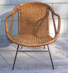 Genuine mid-century chair of natural rattan and wicker with black iron frame and legs. This chair looks like recently sold chairs that were manufactured by Calif-Asia, but is not marked. Assembly is simple: Turn the chair over, push the iron frame into the drilled holes in the wooden chair frame, and tighten the thumb screw to secure. | eBay!