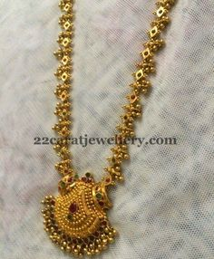 22 carat gold light weight muvvala haram with 16 inches length. Simple spinel rubies and emeralds studded across the long set with gol...