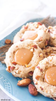These easy salted caramel almond thumbprint cookies are perfect for any party or cookie exchange! They are slightly nutty, sweet, and incredibly rich with salted caramel filling!