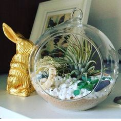Adore this beautiful beachy globe by Ms H.J.M. in Oxford - and that golden bunny!