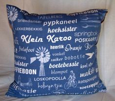 Afrikaans Cushion. Fabric printed with Afrikaans words. by Tripvis, $25.00