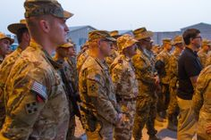 U.S., Romanian and Australian Soldiers wearing the 4th Infantry Division patch watch as Maj. Gen. Paul J. LaCamera, commanding general, Regional Command (South) and 4th Infantry Division, speaks to servicemembers and civilians in front of the RC(S) headquarters June 6, 2014. The speech was part of a ceremony remembering the sacrifices of 4th Inf. Div. Soldiers and others who assaulted the beaches of Normandy 70 years ago on their way to liberating France and the rest of Europe (U.S. Army photo) 4th Infantry Division, Normandy Beach, Regional, Soldiers, Beaches, June, Rest, Army, Europe