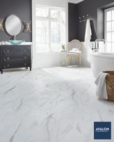 The look of marvelous marble flooring in your bathroom without the high price? Have you met our fabulous friend Adura® Max vinyl tile flooring yet? #vinylflooring #vinylfloors #luxuryvinyltile #bathroomdesign