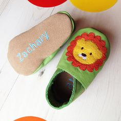 Personalized lion baby shoes from Born Bespoke on Etsy