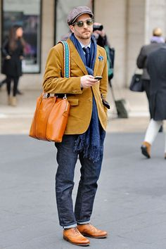 Add a traditional baker boy cap to a deep tobacco blazer and indigo denim. Accessorise with a burnt orange tote and navy scarf to really nail the look.