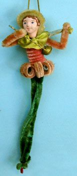 Vintage Christmas clown ornament made of chenille and pipe cleaners, papier mache face.