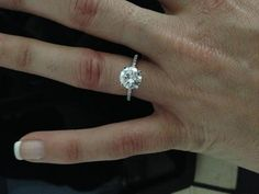 simple 2 ct ring with .5ct small stones on the band... perfection <3
