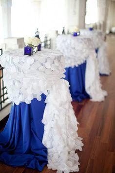 Royal blue linen with white circle confetti overlay using side sash tie. #wedding #reception #cocktailtable #tablescape #blueandwhitewedding