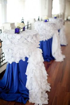 Royal blue linen with white circle confetti overlay using side sash tie. #wedding #reception #cocktailtable #tablescape #blueandwhitewedding