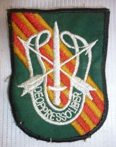 CHEESECLOTH SHOULDER PATCH - T.023 - SPECIAL OPs, Vietnam War, DE OPPRESSO LIBER