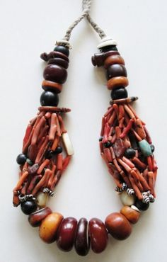 Morocco | Woman's necklace; Amber, coral, cornaline,amazonite, beads, shells, silver on cotton. | Draa Valley.