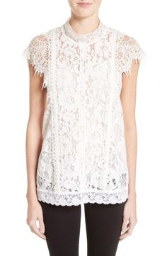 Edwardian in spirit yet timelessly beautiful, this lavish lace blouse trimmed with fluttery eyelash fringe brings a sense of vintage romance to any look.