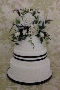 Sugar roses, anemone's and  freesias wedding cake  with Laced embossed flowers  ~ all edible
