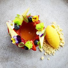 Pineapple-Strawberry Parfait l Mixed Berries l Mango Gel l Crumbled l Passion Fruits Gelato by our talented Pastry Sous Chef @june_artha #dessert #pastry #chefroll #chefspecial #cookniche #foodstarz #foods #foodporn #bali ##legian #padmaresort #resort #newmenu .