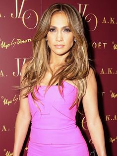 Jennifer Lopez sexy middle part waves with bold eyelashes and glossy lips | allure.com