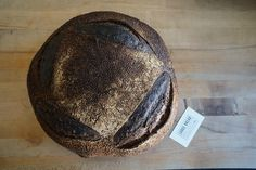 three kilo MICHE for a great customer of ours. we love custom orders like this. loaf is: 60% high extraction wheat 35% one hundred percent whole wheat 5% dark rye. business card for reference point.  #lodgebread #livefreeandbake #michelle by lodgebreadco