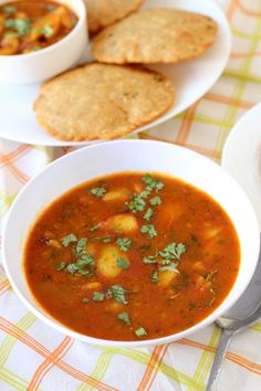 Bedmi aloo sabzi recipe, a tasty runny potato curry that's served with bedmi puri (lentil stuffed puri), a popular North Indian street food