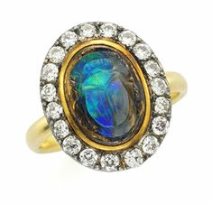An Antique Carved Opal Scarab and Diamond Ring, 19th Century  -  FD