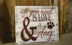 """Wooden """"All you need is love and a dog"""" rustic white washed sign."""