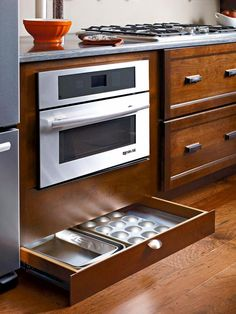 "Most kitchens have toe kicks under their cabinets. This one, however, utilizes those spaces with the toe-kick drawer from Diamond Cabinets. Cabinet featured on DIY Network's ""10 Clever Ways to Keep Your Kitchen Organized."""